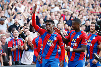 11th September 2021; Selhurst Park, Crystal Palace, London, England;  Premier League football, Crystal Palace versus Tottenham Hotspur: Wilfried Zaha of Crystal Palace celebrates after scoring his goal from a penalty in the 76th minute to make it 1-0 with his team mates
