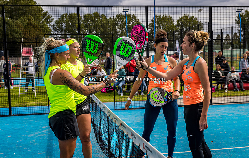 Netherlands, September 6,  2020, Amsterdam, Padel Dam, NK Padel, National  Padel Championships, Chayenne Ewijk (NED) and Rosalie van der Hoek (NED)  (R) win the semifanals and being congratulated in the corona style by  Michaella Krajicek (NED) and Steffie Weterings<br /> Photo: Henk Koster/tennisimages.com
