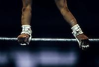 gymnast performing on high bar