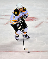 22 April 2009: Boston Bruins' defenseman Dennis Wideman brings the puck out of his end during third period action against the Montreal Canadiens at the Bell Centre in Montreal, Quebec, Canada. The Bruins advance to the Eastern Semi-Finals, eliminating the Canadiens from Stanley Cup competition with their 4-1 win and series sweep. ***** Editorial Sales Only ***** Mandatory Credit: Ed Wolfstein Photo