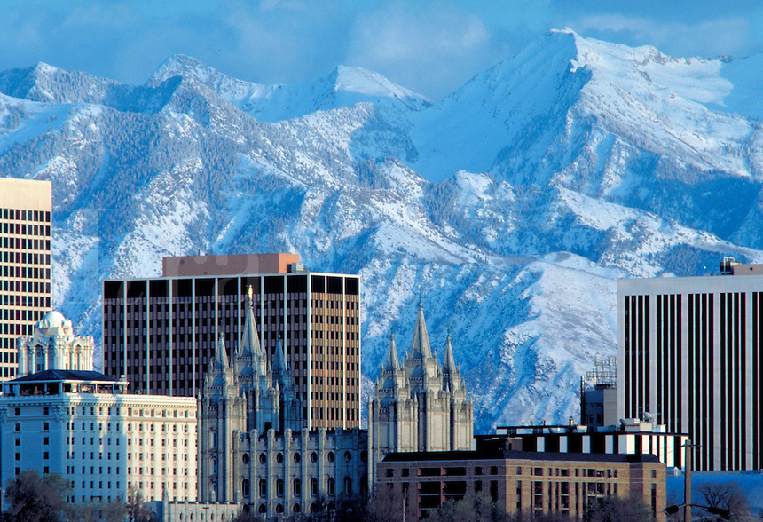 Latter day Saints (Mormon) Temple and office buildings of Salt Lake City, Utah with snowcovered Wasatch Mountains in the background. Winter. cityscape, urban design,. Salt Lake City Utah.