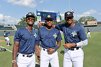 Gerson Molina from Cuba, Hansel Moreno from the Dominican Republic, and Shervyen Newton from Curacao, left to right, all members of the Columbia Fireflies, pose for a photo before a game against the Augusta GreenJackets on Saturday, June 1, 2019, at Segra Park in Columbia, South Carolina. Columbia won, 3-2. (Tom Priddy/Four Seam Images)