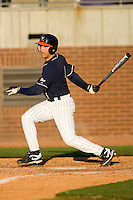 Reed Gragnani #4 of the Virginia Cavaliers follows through on his swing versus the East Carolina Pirates at Clark-LeClair Stadium on February 20, 2010 in Greenville, North Carolina.   Photo by Brian Westerholt / Four Seam Images