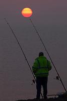 Cley Next The Sea, Norfolk, England, 09/08/2009..Sea fishing at dawn.