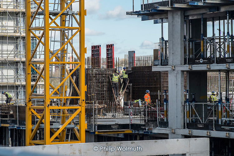 Construction workers building high-rise apartment blocks in Wembley London