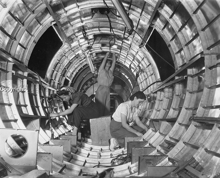 """Women workers install fixtures and assemblies to a tail fuselage section of a B-17F bomber (the """"Flying Fortress"""") at the Long Beach, Calif., plant of Douglas Aircraft Company.  October 1942.  Alfred Palmer. (OWI)<br /> Exact Date Shot Unknown<br /> NARA FILE #:  208-AA-352X-1<br /> WAR & CONFLICT #:  800"""