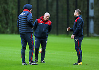 (L-R) Manager Paul Clement, Nigel Gibbs, assistant coach and Karl Halabi, fitness coach wait for the players to arrive during the Swansea City Training at The Fairwood Training Ground, Swansea, Wales, UK. Wednesday 22 November 2017