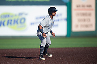 Tri-City Dust Devils catcher Alison Quintero (32) takes a lead off second base during a Northwest League game against the Everett AquaSox at Everett Memorial Stadium on September 3, 2018 in Everett, Washington. The Everett AquaSox defeated the Tri-City Dust Devils by a score of 8-3. (Zachary Lucy/Four Seam Images)