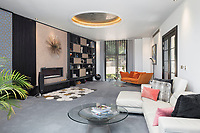 BNPS.co.uk (01202 558833)<br /> Pic: HamptonsInternational/BNPS<br /> <br /> Drawing rooms with views...<br /> <br /> A futuristic 'Hollywood Hills' home which is nestled in the English countryside has emerged on the market for almost £5million.<br /> <br /> Harwin, in Bourne End, Bucks, would not look out of place on the big screen with its striking modern design.<br /> <br /> The five bedroom property which offers stunning views of the Thames Valley has its own cinema, gym and swimming pool.<br /> <br /> It is being sold with estate agent Hamptons International with a guide price of £4.75million.