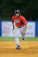 LaMonte Wade (26) of the Elizabethton Twins hustles towards third base against the Kingsport Mets at Hunter Wright Stadium on July 9, 2015 in Kingsport, Tennessee.  The Twins defeated the Mets 9-7 in 11 innings. (Brian Westerholt/Four Seam Images)