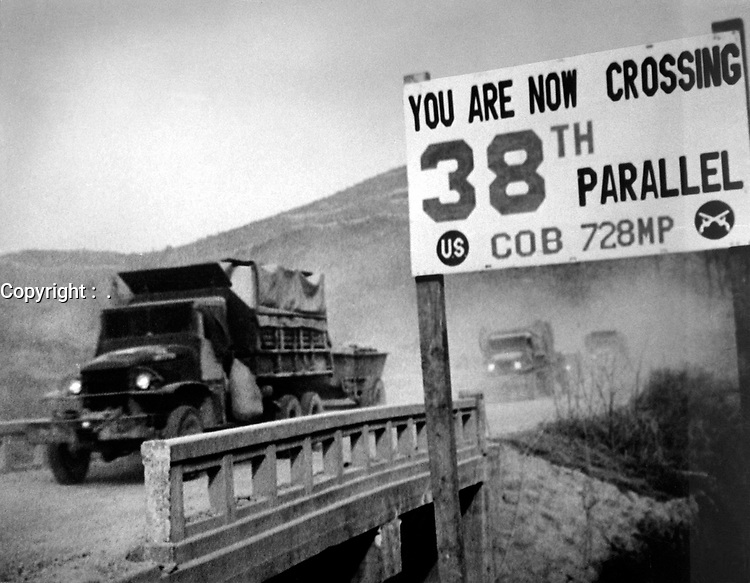 Crossing the 38th parallel.  United Nations forces withdraw from Pyongyang, the North Korean capital.  They recrossed the 38th parallel.  1950. (USIA)<br /> Exact Date Shot Unknown<br /> NARA FILE #:  306-FS-259-21<br /> WAR & CONFLICT BOOK #:  1433