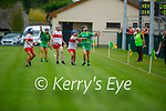 Aine O'Connor of Kerry attempts a hand pass under pressure from Aine McAllister of Derry in the Intermediate Camogie championship