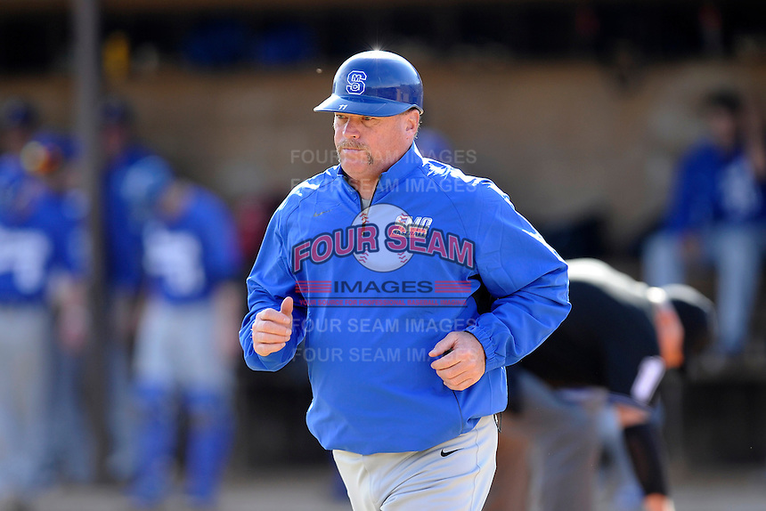 Head coach Tim Wallace of the Spartanburg Methodist College Pioneers heads to his position as third base coach in a junior college game against Lenoir Community College on February 2, 2014, at Mooneyham Field in Spartanburg, South Carolina. SMC won 23-8. (Tom Priddy/Four Seam Images)