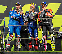 29th August 2021; Silverstone Circuit, Silverstone, Northamptonshire, England; MotoGP British Grand Prix, Race Day; The podium riders pose with the Prosecco