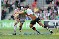 Julian Salvi of Leicester Tigers is tackled by Nick Easter of Harlequins during the Aviva Premiership match between Harlequins and Leicester Tigers at The Twickenham Stoop on Saturday 21st April 2012 (Photo by Rob Munro)