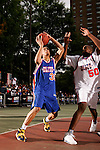 Michael Beasley (30) drives to the basket with defense by Samardo Samuels (50) during the Elite 24 Hoops Classic game on September 1, 2006 held at Rucker Park in New York, New York.  The game brought together the top 24 high school basketball players in the country regardless of class or sneaker affiliation.