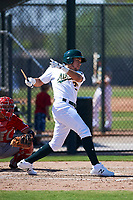 Rafael Rincones (29) of the Oakland Athletics follows through on a swing after breaking his bat during an Instructional League game against the Cincinnati Reds on September 29, 2017 at Lew Wolff Training Complex in Mesa, Arizona. (Zachary Lucy/Four Seam Images)