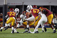 LOS ANGELES, CA - SEPTEMBER 11: Thomas Booker #4 of the Stanford Cardinal tackles Vavae Malepeai #6 of the USC Trojans during a game between University of Southern California and Stanford Football at Los Angeles Memorial Coliseum on September 11, 2021 in Los Angeles, California.