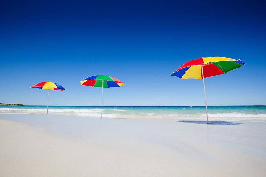 Three beach umbrellas Australia