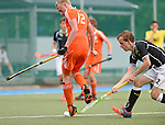 GER - Mannheim, Germany, May 25: During the U16 Boys match between The Netherlands (orange) and Germany (black) during the international witsun tournament on May 25, 2015 at Mannheimer HC in Mannheim, Germany. Final score 3-4 (1-2). (Photo by Dirk Markgraf / www.265-images.com) *** Local caption *** Tjep Hoedemakers #12 of The Netherlands, Tino Volkert #22 of Germany