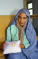 A women custom officer of the Northern Alliance commander, Qasir Kabir, has two hundred kilograms of heroin worth $800,000 he says he must burn and destroy in the name of Allah.