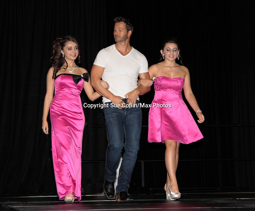 """Days of Our Lives Eric Martsolf """"Brady Black"""" appears at the 12th Annual Comcast Women's Expo on September 7 (also 6th), 2014 at the Connecticut Convention Center, Hartford, CT as he walked the runway with models from Kathy Faber Designs Fashion Show.  (Photo by Sue Coflin/Max Photos)"""