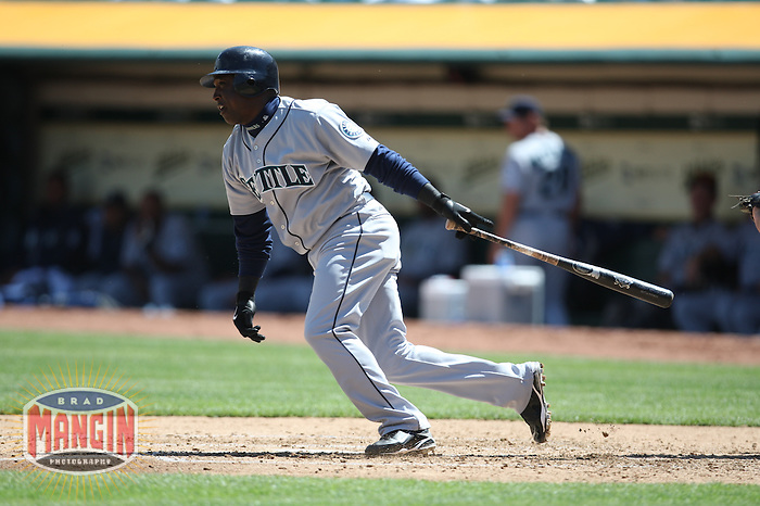 OAKLAND, CA - APRIL 11:  Yuniesky Betancourt of the Seattle Mariners bats during the game against the Oakland Athletics at the Oakland-Alameda County Coliseum in Oakland, California on Saturday, April 11, 2009.  The Mariners defeated the A's 8-5.  Photo by Brad Mangin