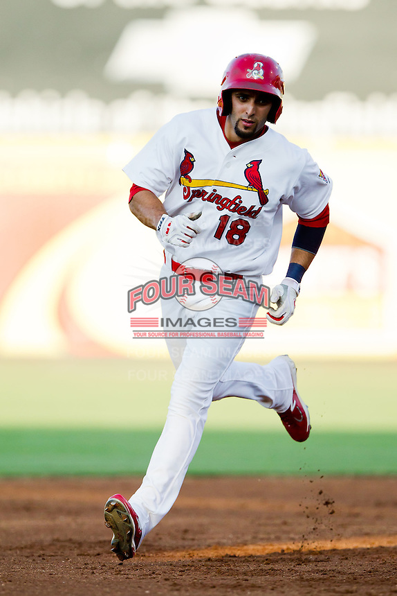 Alex Castellanos (18) of the Springfield Cardinals rounds the bases after hitting a home run during a game against the Tulsa Drillers at Hammons Field on July 20, 2011 in Springfield, Missouri. Springfield defeated Tulsa 12-1. (David Welker / Four Seam Images)