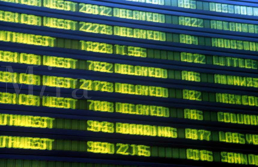 Flight arrivals information board at Sky Harbour Airport, Phoenix, Arizona.
