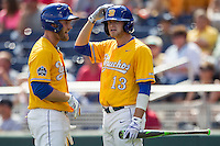 UC Santa Barbara Gauchos catcher Dempsey Grover (20) talks with teammate Ryan Clark (13) during a timeout against the Miami Hurricanes in Game 5 of the NCAA College World Series on June 20, 2016 at TD Ameritrade Park in Omaha, Nebraska. UC Santa Barbara defeated Miami  5-3. (Andrew Woolley/Four Seam Images)