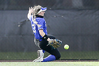 Rogers center fielder Jenna Williams (3) retrieves the ball, Thursday, April 29, 2021 during a softball game at Bentonville High School in Bentonville. Check out nwaonline.com/210430Daily/ for today's photo gallery. <br /> (NWA Democrat-Gazette/Charlie Kaijo)