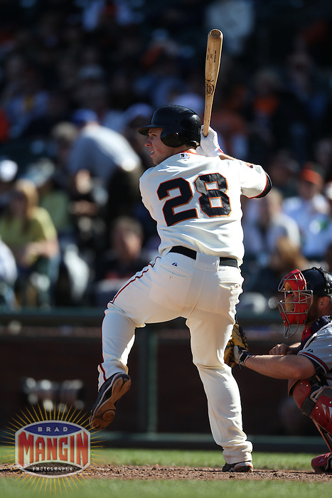 SAN FRANCISCO - APRIL 24:  Buster Posey #28 of the San Francisco Giants bats against the Atlanta Braves during the game at AT&T Park on April 24, 2011 in San Francisco, California. Photo by Brad Mangin