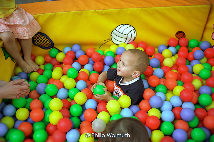 A child plays in the creche at Walterton and Elgin Community Homes (WECH) 10th Anniversary street party.