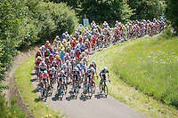 "peloton over le ""Petit Poggio""  with Team OmegaPharma-QuickStep closing the door and preventing other riders to pass<br /> <br /> 2014 Belgium Tour<br /> stage 4: Lacs de l'Eau d'Heure - Lacs de l'Eau d'Heure (178km)"