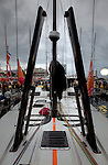 Preparation one day before the start of the Barcelona World Race, Barcelona, Spain..Alex Thomson and Andy Meiklejohn crew on the IMOCA 60 Hugo Boss design by Juan kouyoumdjian  preparing for the Barcelona World Race..The Barcelona World Race is the first only double-handed (two-crew) regatta around the world. This is a non-stop regatta with some outside assistance permitted, although subject to rules and  penalties.