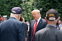US President Donald J. Trump, greets Korean War veterans at the Korean War Veterans Memorial in Washington, DC, USA, 25 June 2020. On 24 June, in the wake of anti-racism protests aimed at monuments around the country, the president activated the National Guard to provide unarmed security for monuments in the nation's capital.<br /> Credit: Jim LoScalzo / Pool via CNP/AdMedia