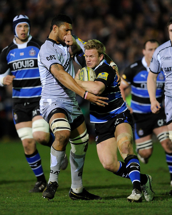 Michael Claassens of Bath Rugby is tackled by Steve Mafi of Leicester Tigers during the LV= Cup semi final match between Bath Rugby and Leicester Tigers at The Recreation Ground, Bath (Photo by Rob Munro, Fotosports International)