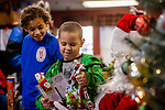 TORRINGTON, CT. 20 December 2019-122019BS09 - Mason Perez, 7, reacts after opening up his gift given to him by Santa as his brother Tyler Perez, 9, left, both of Torrington looks on, during a visit by Santa at the FISH of Northwestern Connecticut Homeless Shelter on Friday. Bill Shettle Republican-American