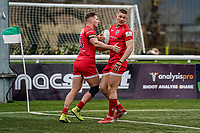 Alex Morgan of Jersey Reds (left) celebrates with George Spencer of Jersey Reds (right) after he scores his team's first try during the Championship Cup QF match between Ealing Trailfinders and Jersey Reds at Castle Bar, West Ealing, England  on 22 February 2020. Photo by David Horn.
