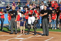 Umpire Derek Moccia, Batavia Muckdogs catcher Chad Wallach #55, and umpire James Pattison stand with a young fan during the national anthem before a game against the Mahoning Valley Scrappers on June 21, 2013 at Dwyer Stadium in Batavia, New York.  Batavia defeated Mahoning Valley 3-2.  (Mike Janes/Four Seam Images)