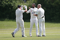 A Malik of Hornchurch celebrates with his team mates after taking the wicket of O Harmer during Billericay CC (batting) vs Hornchurch CC, Hamro Foundation Essex League Cricket at the Toby Howe Cricket Ground on 12th June 2021