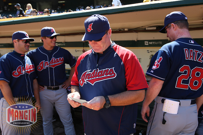 OAKLAND, CA - SEPTEMBER 20:  Manager Eric Wedge #22 of the Cleveland Indians gets ready in the dugout before the game against the Oakland Athletics at the Oakland-Alameda County Coliseum on September 20, 2009 in Oakland, California. Photo by Brad Mangin