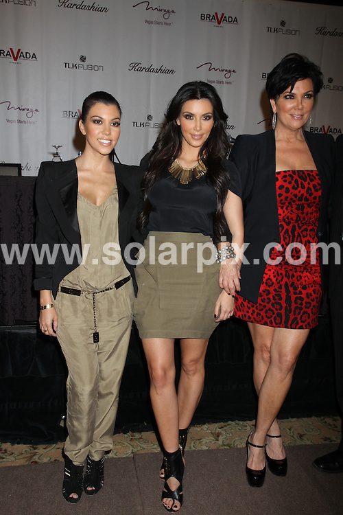 **ALL ROUND PICTURES FROM SOLARPIX.COM**.**SYNDICATION RIGHTS FOR UK, AUSTRALIA, DENMARK, PORTUGAL, S. AFRICA, SPAIN & DUBAI (U.A.E) & ASIA (EXCLUDING JAPAN) ONLY**.Bravada International, the Kardashians, the Mirage and TLK Fusion's New Kardashian Retail Project Press Conference,The Mirage Ballroom at the Mirage Hotel and Casino, Las Vegas, NV, USA, 28 June 2010.This pic: Kim Kardashian, Kourtney Kardashian and Kris Jenner.JOB REF: 11582     PHZprn    DATE: 28_06_2010 .**MUST CREDIT SOLARPIX.COM OR DOUBLE FEE WILL BE CHARGED**.**MUST NOTIFY SOLARPIX OF ONLINE USAGE**.**CALL US ON: +34 952 811 768 or LOW RATE FROM UK 0844 617 7637**