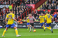 Sheffield United's midfielder John Fleck (4) takes on Leeds United's midfielder Mateusz Klich (43) during the Sky Bet Championship match between Sheff United and Leeds United at Bramall Lane, Sheffield, England on 1 December 2018. Photo by Stephen Buckley / PRiME Media Images.