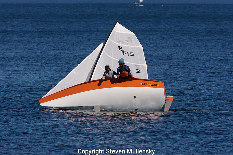 The Habanero, a fifteen foot class sailboat named after a spicy chili, heels over while sailing into to the wind on Port Townsend Bay.
