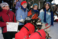 Wednesday March 14, 2007   ----   Shortly after his arrival in Nome in 13th place, Norwegian Robert Sorlie's dogs get a pet from several girls from Wasilla Lake Christian School who are on a missions trip to Nome.