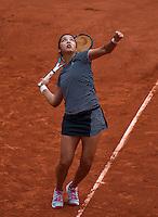 Paris, France, 25 June, 2016, Tennis, Roland Garros,  Zarina Diyas (KAZ) serves<br /> Photo: Henk Koster/tennisimages.com