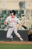 Michael Chavis (11) of the Greenville Drive follows through on his swing against the Kannapolis Intimidators at Intimidators Stadium on June 8, 2016 in Kannapolis, North Carolina.  The Intimidators defeated the Drive 3-2.  (Brian Westerholt/Four Seam Images)