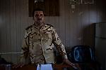 Irak - Suedlich von Kirkuk. Der zustaendige Peschmerga Oberbefehlshaben fuer den Frontabschnitt Kirkuk.<br /> <br /> Engl.: Asia, Iraq, south of Kirkuk, conflict area, Peshmerga commander-in-chief, man, June 2014 <br /> <br /> || Die Front zwischen Peschmerga Kaempfern und ISIS Milizen ist schwerstens bewaffnet. Seit Tagen wird hier gekaempft mit vielen Verusten auf beiden Seiten. ISIS Kaempfer liegen zwischen 1-3km von den Peschmergas entfernt, beide haben Scharfschuetzen in Stellung gebracht.