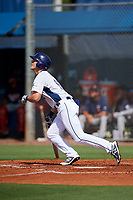 GCL Rays designated hitter Joe McCarthy (15) follows through on a swing during a game against the GCL Twins on August 9, 2018 at Charlotte Sports Park in Port Charlotte, Florida.  GCL Twins defeated GCL Rays 5-2.  (Mike Janes/Four Seam Images)